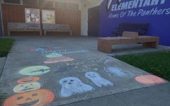 Renaissance Promotion committee members brighten up the campus of Palm Elementary School with chalk art just in time for Halloween. Photo by Giovanna Fernandez