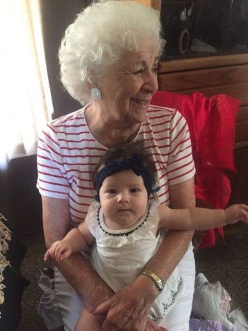 Anita Acuña smiles wide with her grandchild, reflecting on the Polio epidemic during a new pandemic, COVID-19. Photo by Lauren Stratton.