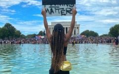 From Instagram user @venturewithv, boldly standing her ground amidst thousands at a Black Lives Matter protest.