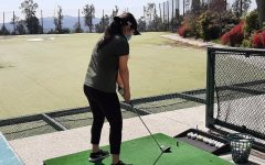 Sophomore Serena Wong focuses on getting the right posture to hit the ball. Photo by Rufina Chow